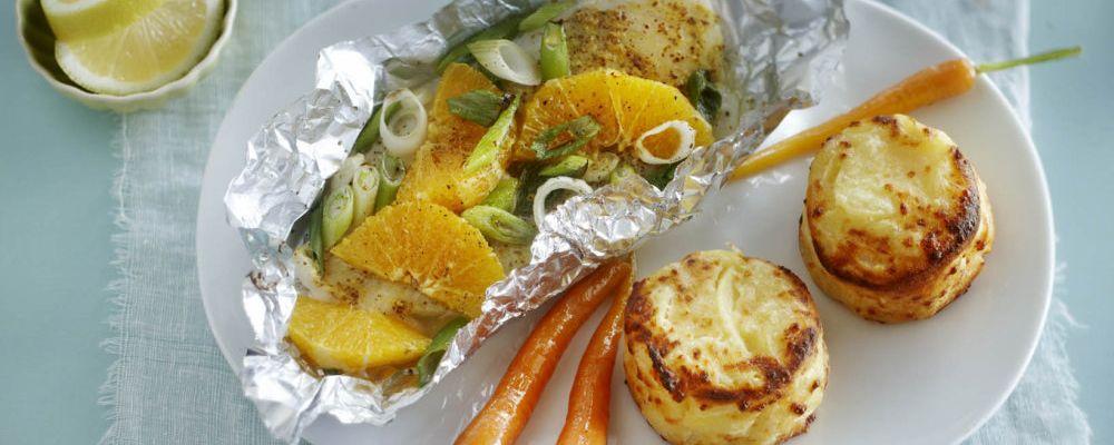 Gratiny ziemniaczane z serem Ementaler, porcją dorsza i kandyzowaną marchewką